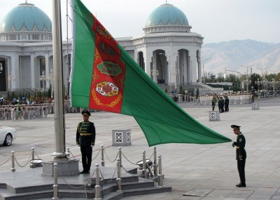 Soldiers raise the national flag during a military parade marking Turkmenistan's Independence Day, in Ashgabat on October 27, 2013. AFP PHOTO / STR        (Photo credit should read -/AFP/Getty Images)