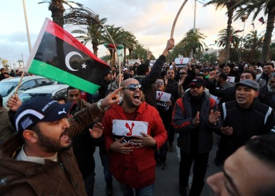 Libyan protestors hold placards as they demonstrate against the extended mandate of the General National Congress, the country's highest political authority, in Tripoli's Martyr square, on December 27, 2013. AFP PHOTO/MAHMUD TURKIA        (Photo credit should read MAHMUD TURKIA/AFP/Getty Images)