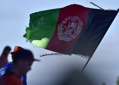 An old Afghanistan flag flies during the Pool A 2015 Cricket World Cup cricket match between New Zealand and Afghanistan at McLean Park in Napier on March 8, 2015.  AFP PHOTO / MARTY MELVILLE        (Photo credit should read Marty Melville/AFP/Getty Images)
