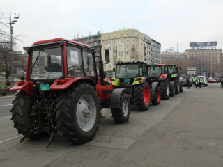 Tractors line up in front of parliament during a protest against the law.