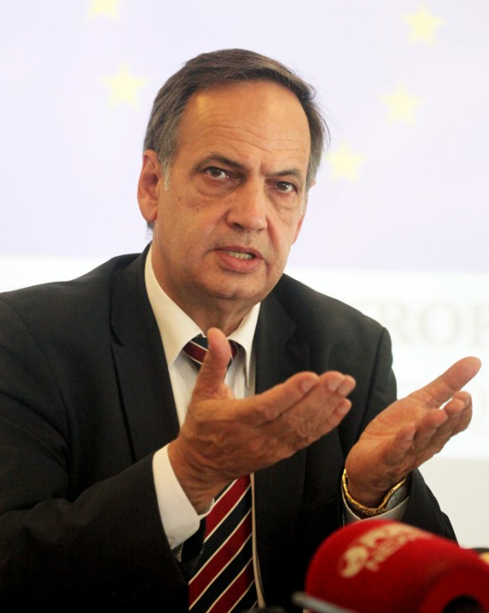 European Parliamentarian Knut Kleckenstein speaks at a news conference in Tirana, Albania, Monday July 18, 2016. Fleckenstein warned Albanian politicians to pass a judicial reform later this week or launching the membership negotiations with the European Union will not be possible. (AP Photo/Hektor Pustina)